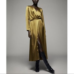 Most luxurious satin effect shoulder pad dress.